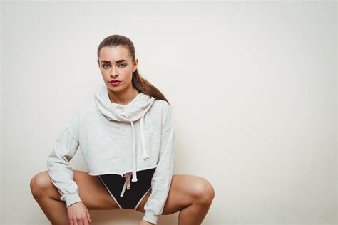Pretty woman crouching in hip hop dance studio Photo from