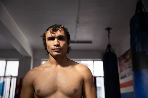 Low angle view of fit man looking at camera in boxing gym