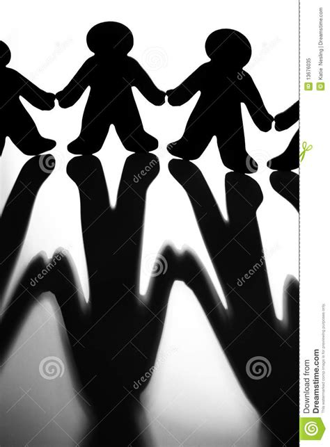 Black And White Image Of Silhoutted Figures Joinin Stock